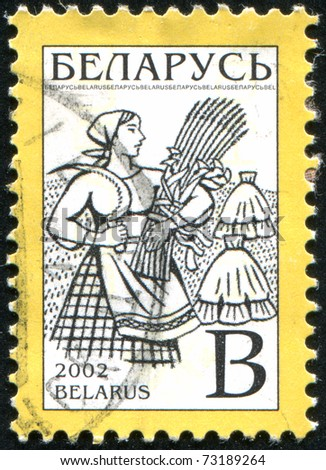 BELARUS - CIRCA 2002: stamp printed by Belarus, shows peasant woman, circa 2002.