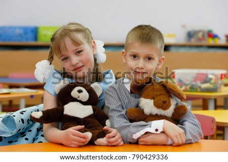 Belarus, Gomel, April 13, 2017, Gomel kindergarten, Preschooler with toys. Little brother and sister.