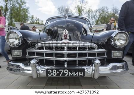 "Belarus, Minsk, may, 07.2016: International festival of retro cars ""Retrominsk"" in Minsk.headlight and radiator front view of a retro car - stock photo"