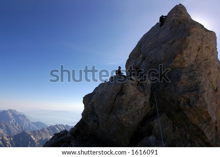 Belaying the last pitch on the Grand Teton 13770' - stock photo