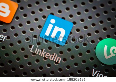 BELCHATOW, POLAND - APRIL 10, 2014: Closeup photo of Linkedin icon on mobile phone screen. Popular social network. - stock photo