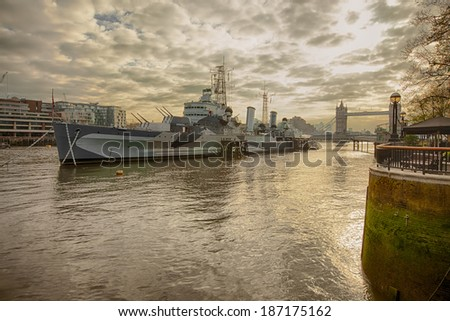 Belfast battleship on a river Thames on a cloudy morning - stock photo