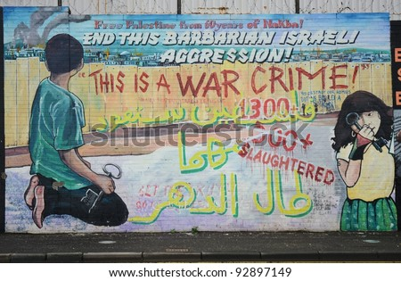 BELFAST, NORTHERN IRELAND - DECEMBER 31: a mural criticises Israeli aggression in Palestine on December 31, 2011 in Belfast, Northern Ireland.