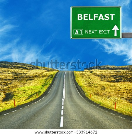 BELFAST road sign against clear blue sky - stock photo