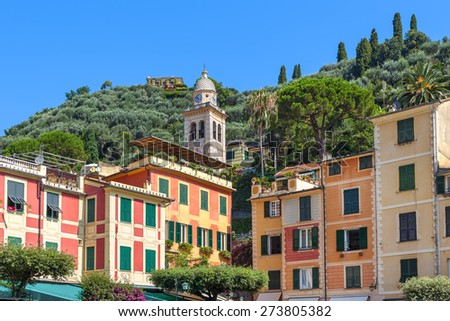 Belfry among typical colorful houses of Portofino - popular resort on Italian Riviera. - stock photo