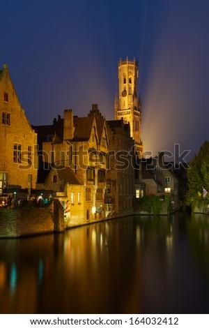Belfry in Bruges at dusk - stock photo