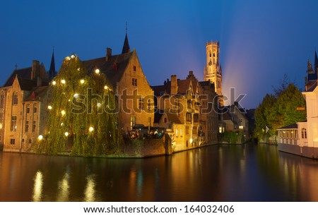 Belfry in Bruges at dusk with a swirl - stock photo