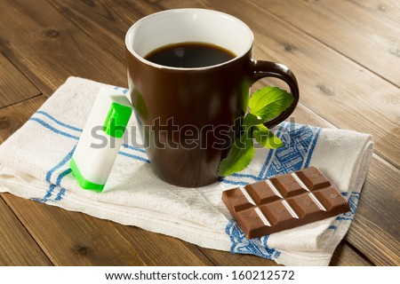 Belgian chocolate made with stevia instead of sugar and a cup of coffee with stevia tabs - stock photo