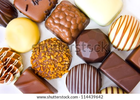 Belgian chocolates on white background view from above
