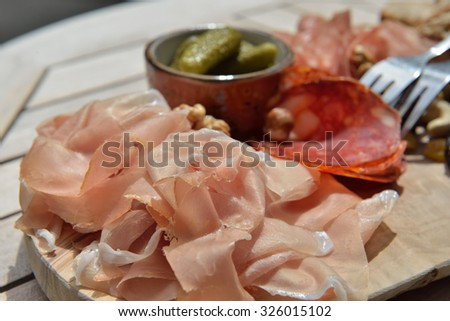 Belgian delicatessen on a wooden desk in sunny day closeup photo - stock photo