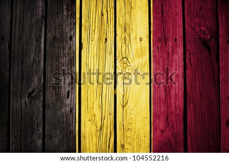 belgian flag painted on grunge wooden texture - stock photo