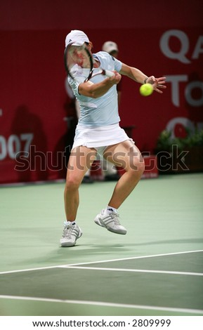 Belgian tennis star Justine Henin in action against Alicia Molik at the Qatar Total Open, Doha, February 28, 2007, which Henin won.
