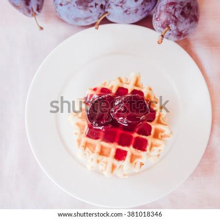 Belgian waffle with plum jam - stock photo