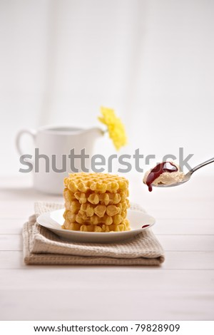 belgian waffles and ice cream in the dish on a white table - stock photo