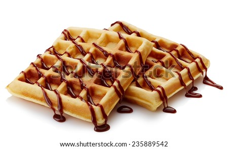 Belgian waffles with chocolate sauce isolated on white background - stock photo