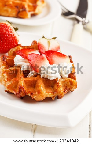 belgian waffles with fresh strawberries and whipped cream - stock photo