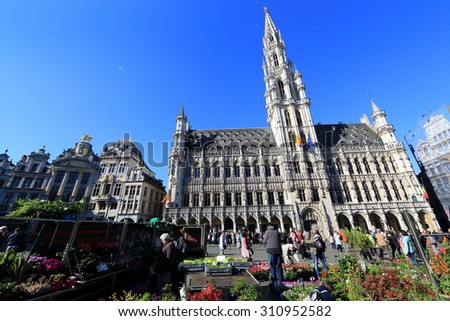 BELGIUM, BRUSSELS - April 18, 2015: Grand Place in Brussels with unidentified people. The square is the most important tourist destination and memorable landmark in Brussels