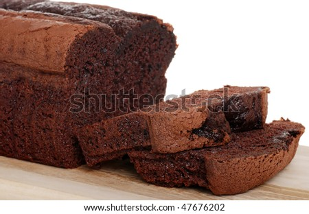 belgium chocolate cake loaf focus on slice - stock photo