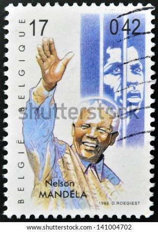 BELGIUM - CIRCA 1999: A stamp printed in Belgium showing an image of Nelson Mandela, circa 1999. - stock photo