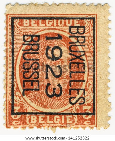 BELGIUM - CIRCA 1922: A stamp printed in Belgium shows portrait King Albert I (1875-1934) and stamp Brussel 1923, circa 1922