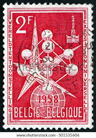 BELGIUM - CIRCA 1958: a stamp printed in the Belgium shows The Atom and Exposition Emblem, 1958 Worlds Fair at Brussels, circa 1958 - stock photo