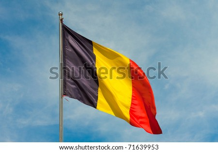 belgium flag on a pole over beautiful sky - stock photo