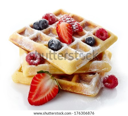 Belgium waffles with fresh berries and caster sugar isolated on white background - stock photo