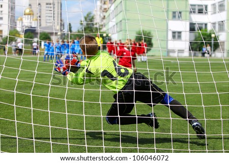 "BELGOROD, RUSSIA - JUNE 17: Unidentified goalkeeper from football team ""Olympia"" jumping during penalty on June 17, 2012 in Belgorod, Russia. Chernozemie Superiority. Team of 2001 year of  birth. - stock photo"