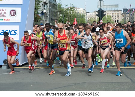 "BELGRADE-APRIL 27:A group of runners in start on ""27th Belgrade Marathon"".April 27, 2014 in Belgrade, Serbia  - stock photo"