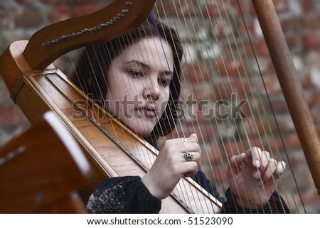 "BELGRADE - APRIL 16: Girl from ""Ensemble Renaissance"" is playing harp during ""Days of Belgrade"" April 16, 2010 in Belgrade, Serbia. - stock photo"