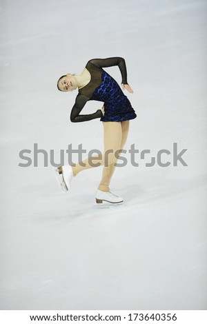 "BELGRADE - JANUARY 24: Slovenia's Pina Umek performs her short program at  Europa Cup figure ice skating competition ""Skate Helena"" in Belgrade, Serbia on January 24, 2014 - stock photo"