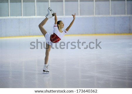 "BELGRADE - JANUARY 22: young girl  performs free ice skating at Europa Cup figure skating competition ""Skate Helena"" in Belgrade, Serbia on January 22, 2014 - stock photo"