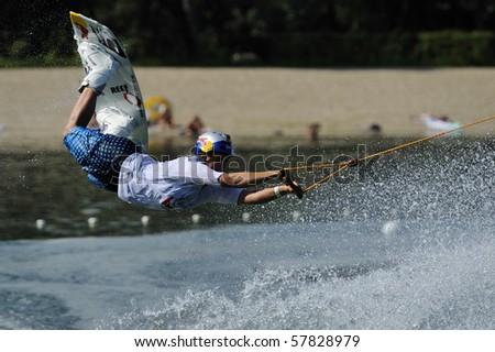 "BELGRADE - JULY 3: Denise de Haan jumps with wakeboard during ""Belgrade International CWWC Wakeboard Stop by IWWF"" July 3, 2009 in Belgrade, Serbia. - stock photo"