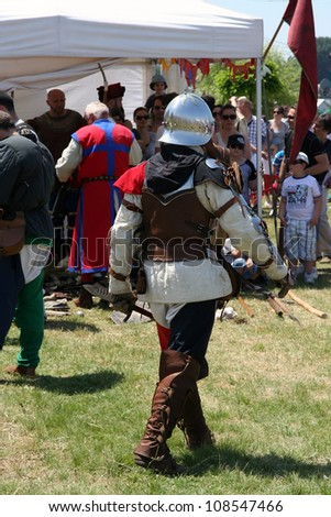 BELGRADE - JUNE 3: An armored spearman on the field at annual Knight tournament on June 3, 2012 in Belgrade, Serbia.