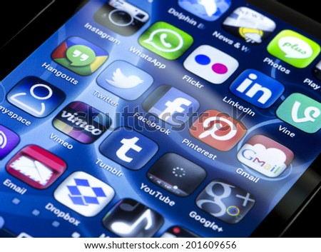 BELGRADE - JUNE 30, 2014 Popular social media icons Twitter, Facebook and other on smart phone screen close up - stock photo