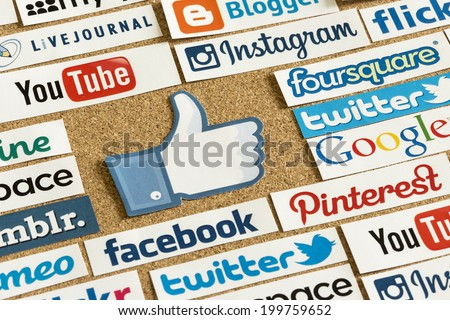BELGRADE - JUNE 17, 2014 Social media website logos Facebook, Twitter and other with like logo printed on paper and pinned on cork bulletin board - stock photo