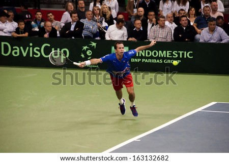 BELGRADE-NOVEMBER 15:Player R.Stepanek (CZE) run for a ball during a match against N.Djokovic (SRB) in final Davis Cup Serbia-Czech Republic.N.Djokovic won 3:0,on November 15,2013 in Belgrade,Serbia  - stock photo