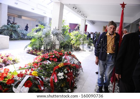 BELGRADE - OCTOBER 26: People passing by the grave of Jovanka Broz, former Yugoslavia's first lady's funeral in Belgrade, Serbia, October 26, 2013 - stock photo