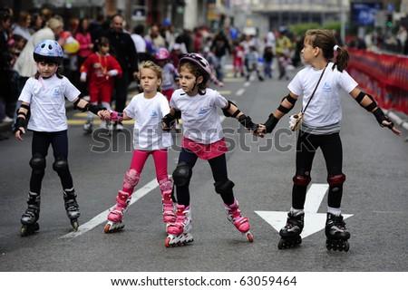 "BELGRADE - OCTOBER 3: Unidentified children compete at the ""13th Chipsy Belgrade Rollerskates Race"" on October 3, 2010 in Belgrade, Serbia - stock photo"
