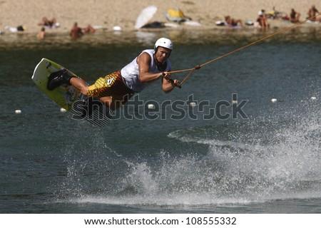 "BELGRADE - SEPTEMBER 4: Oleg Sokolovskiy rides wakeboard during ""13 cable wakeboard european championship"" September 4, 2011 in Belgrade, Serbia. - stock photo"