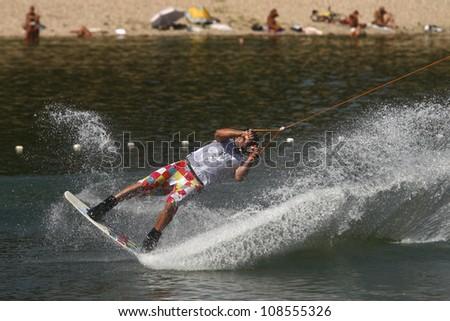"BELGRADE - SEPTEMBER 4: Planinko Dekovic rides wakeboard during ""13 cable wakeboard european championship"" September 4, 2011 in Belgrade, Serbia. - stock photo"
