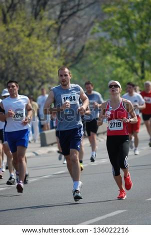 BELGRADE, SERBIA - APRIL 21: A group of marathon competitors during the 26th Belgrade Marathon on April 21, 2013 in Belgrade, Serbia - stock photo