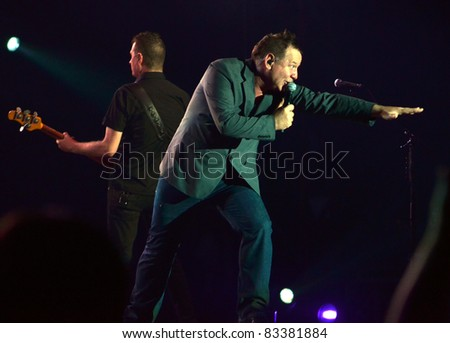 BELGRADE, SERBIA-AUGUST 18: Jim Kerr and Charlie Burchill, the core of the band Simple Minds, perform at the Belgrade Beer Fest on August 18, 2011 in Belgrade, Serbia - stock photo