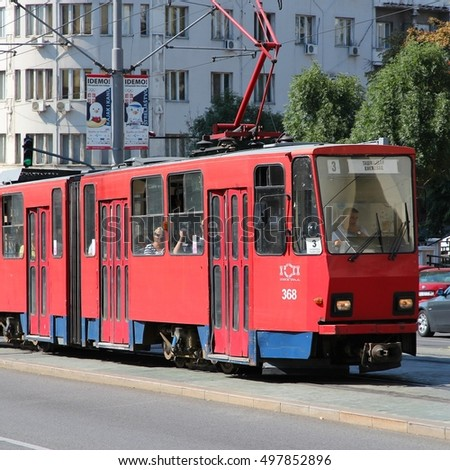 BELGRADE, SERBIA - AUGUST 15, 2012: People ride tram August 15, 2012 in Belgrade, Serbia. Belgrade tram system exists since 1892 and is among largest in Europe today with 127km length of lines.