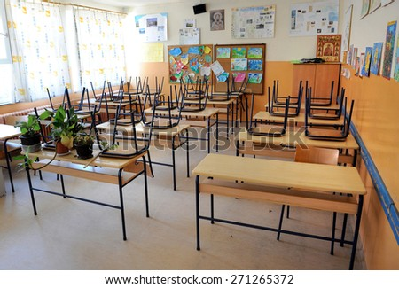 BELGRADE, SERBIA - CIRCA AUGUST 2010: Chairs and tables at empty school classroom waits for pupils, circa August 2010 in Belgrade   - stock photo