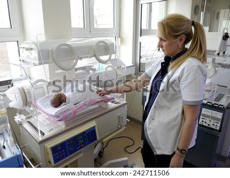 BELGRADE, SERBIA - CIRCA DECEMBER 2014: Nurse takes care of new born babies in maternity hospital, circa December 2014 in Belgrade
