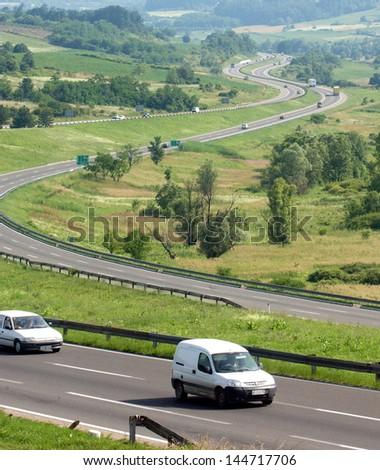 BELGRADE, SERBIA - CIRCA JUNE 2006: Vehicles passes by highway E-75 on corridor 10 thru Serbia circa June 2006 in Belgrade - stock photo