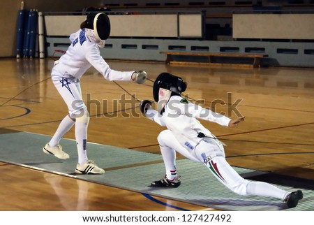 "BELGRADE,SERBIA-DECEMBER1:Fencer Marinuk Avital(ISR) fight against Mihaly Kata(HUN) on the ""57. International Trophy of Belgrade"" Mihaly won.December1,2012 in Belgrade,Serbia - stock photo"