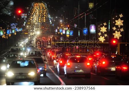 BELGRADE, SERBIA - DECEMBER 12, 2014: Rush hour on Belgrade streets under New Year's lighting