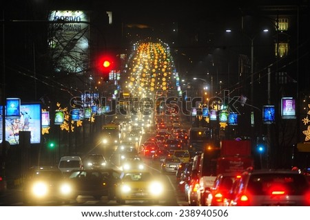 BELGRADE, SERBIA - DECEMBER 12, 2014: Rush hour on Belgrade streets under New Year's lighting - stock photo